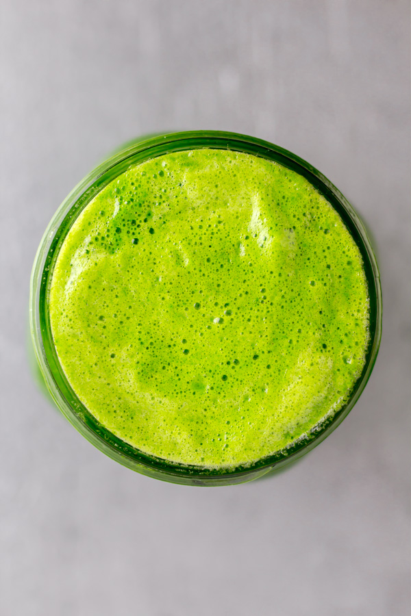 A mason jar top view of green juice