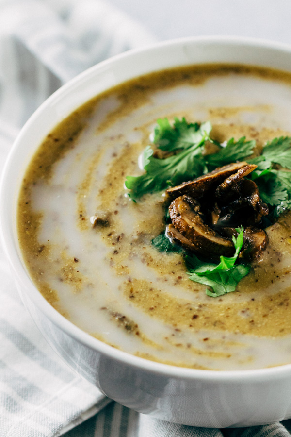 a bowl of vegan mushroom soup topped with cilantro