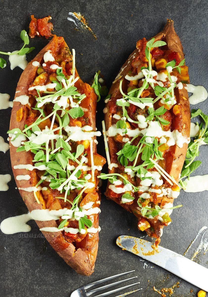 vegan stuffed sweet potatoes with garlic tahini dressing