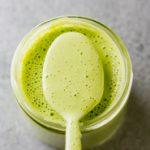 a cup with cilantro garlic sauce