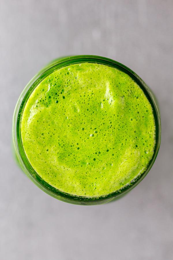 A mason jar top view of green juice
