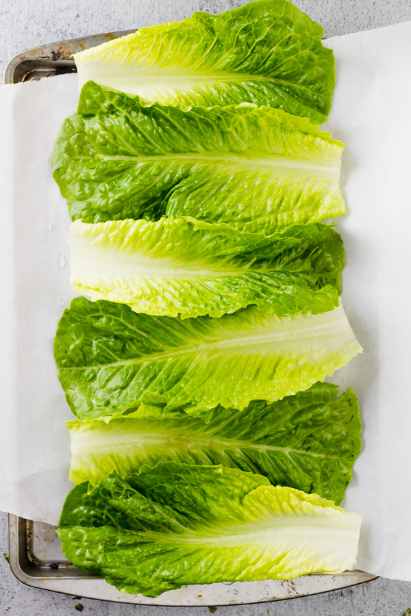 romaine lettuce leaves on parchment paper