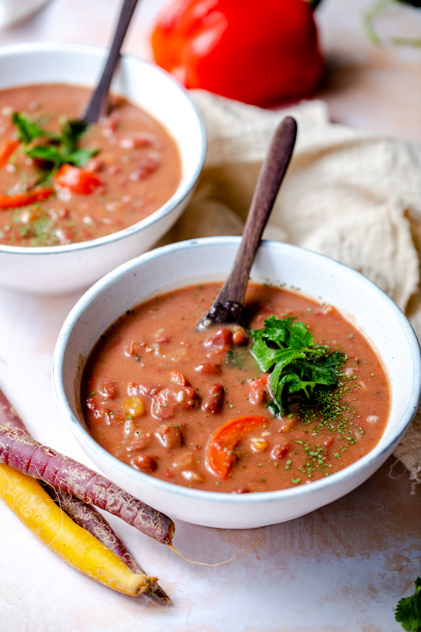Two bowls with vegan red kidney bean soup