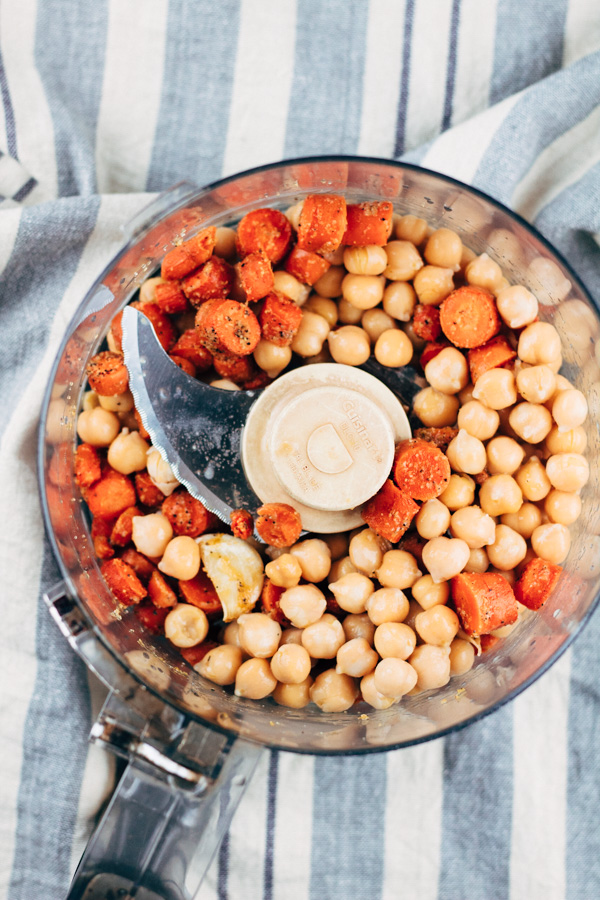 food processor with chopped carrots and chickpeas