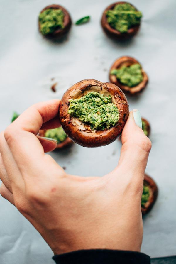 holding a kale pesto stuffed mushroom