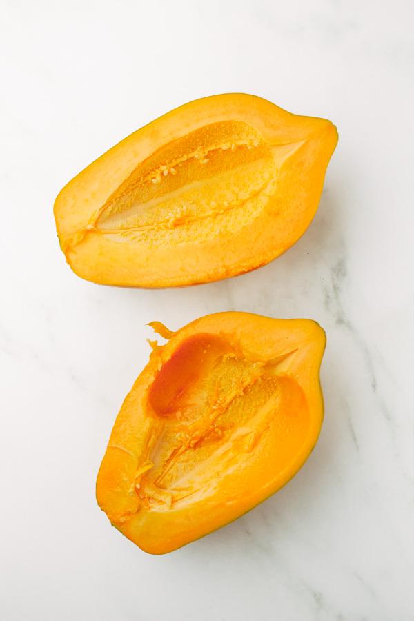 two fresh papaya fruits