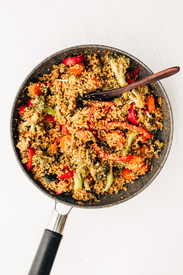 a pan with healthy vegan quinoa fried rice served inside