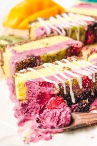 a close up shot of raw vegan berry mango frozen fruit cake bars