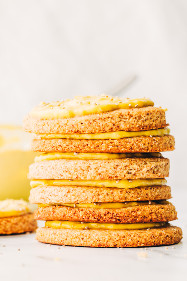 vegan vanilla almond cookies stacked up high