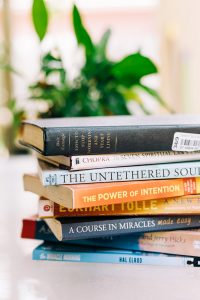 A stack of inspiring books that will change your life forever