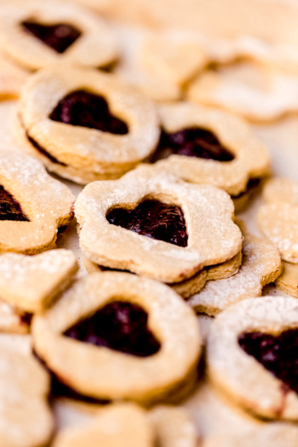 A pile of vegan linzer cookies on a table