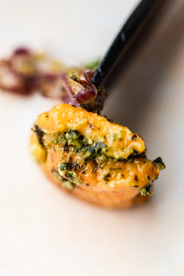 A piece of stuffed gnocchi pesto with sweet potato