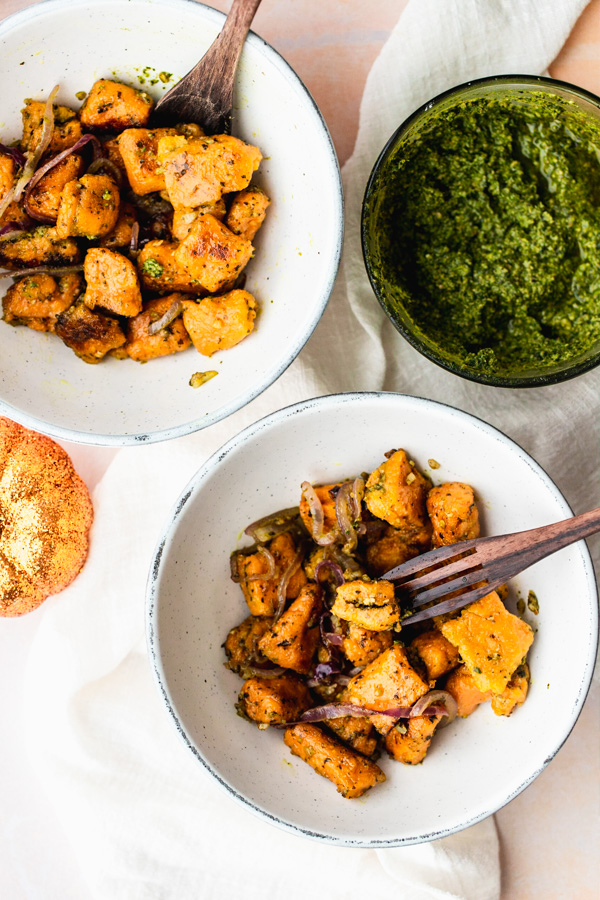 two bowls with stuffed vegan sweet potato gnocchi with pesto