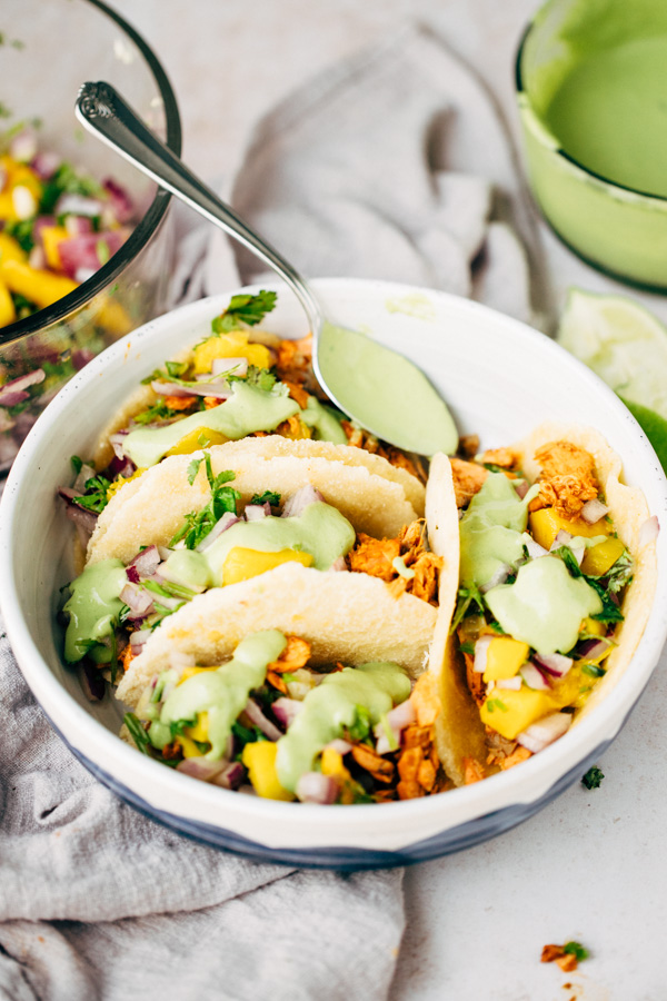 salmon fish tacos served in a bowl with cilantro sauce on top