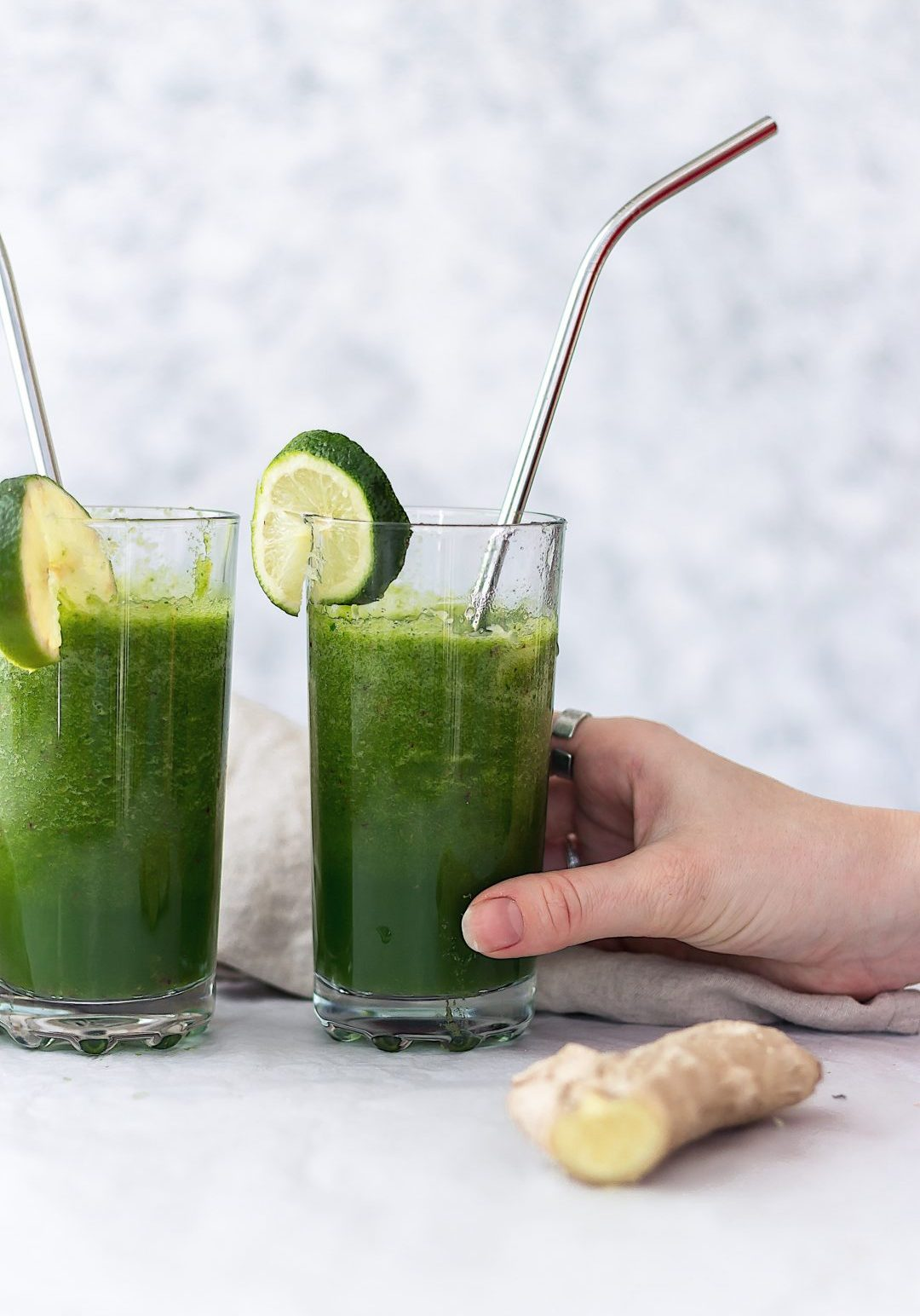 two glass cups with green juice