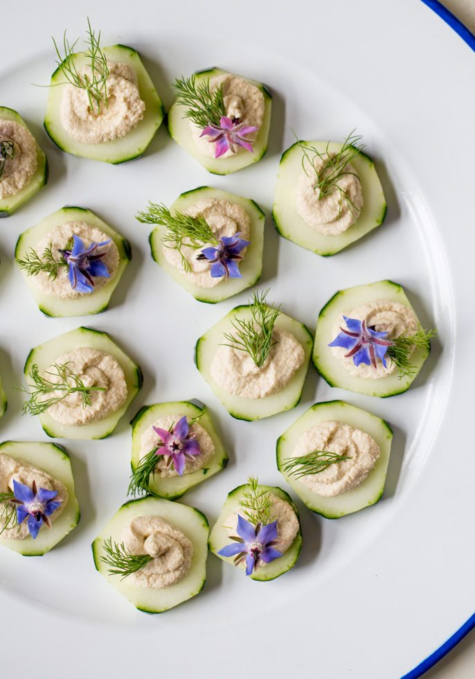 cucumber-slices-with-sunflower-seed-pate-and-borage