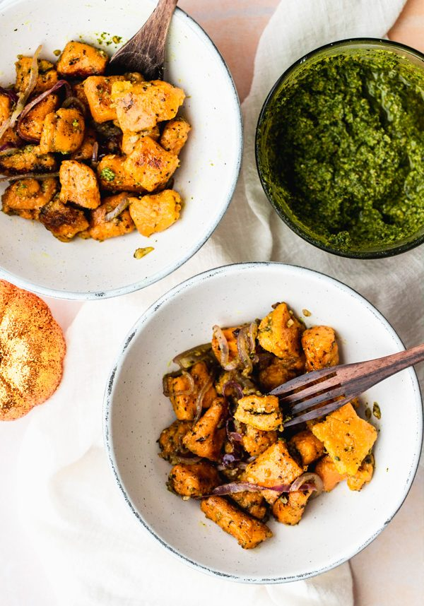 two bowls with stuffed vegan sweet potato gnocchi with pesto